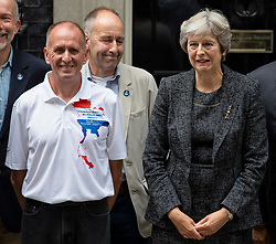 © Licensed to London News Pictures. 24/07/2018. London, UK. British diver Vern Unsworth (L), who played a leading role in the operation to rescue a group of boys trapped in a cave in Thailand, and Prime Minister Theresa May (R) pose for a photograph outside 10 Downing Street during a reception for those that helped with the Thai cave rescue operation. Photo credit: Rob Pinney/LNP