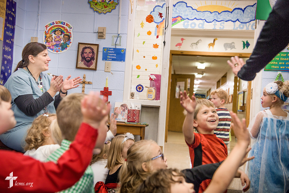 Kindergartners in Linda Pfeiffer's class cheer on a costume parade from another class on Friday, Oct. 28, 2016, at First Immanuel Lutheran School in Cedarburg, Wis. LCMS Communications/Erik M. Lunsford