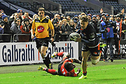 Darcy Graham breaks a tackle to score try during the Guinness Pro 14 2018_19 match between Edinburgh Rugby and Southern Kings at BT Murrayfield Stadium, Edinburgh, Scotland on 5 January 2019.
