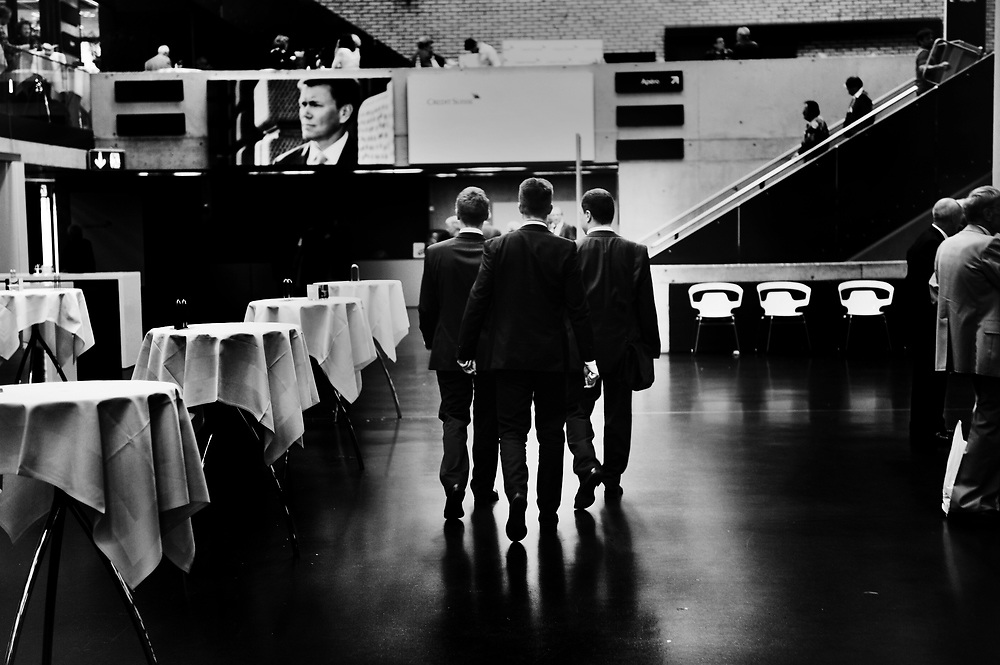 Bank staff at the end of Credit Suisse Annual General Meeting of shareholders in a conference centre in a  Zurich suburb.