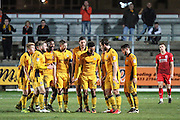 Newport County players celebrate Rhys Healey's goal, 1-0, during the The FA Cup match between Newport County and Alfreton Town at Rodney Parade, Newport, Wales on 15 November 2016. Photo by Andrew Lewis.