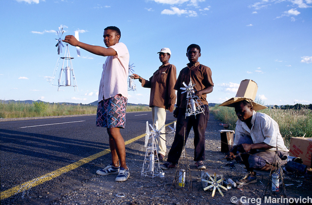 Northern Cape, South Africa 1994. Young men sell toy windmill curios at the side of the road as Nelson Mandela's campaign tour trabvelled to the Northern Cape in 1994.