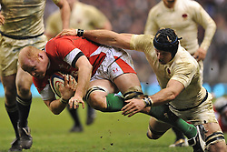 James Haskell (England) makes a grab for Martyn Williams (Wales) during the RBS 6 Nations Championship match between England and Wales at Twickenham Stadium on February 6, 2010 in London, England.