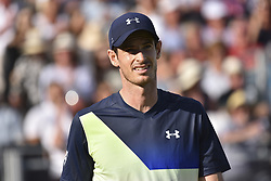 June 19, 2018 - London, England, United Kingdom - Britain's Andy Murray reacts to Australia's Nick Kyrgios during their first round men's singles match at the ATP Queen's Club Championships tennis tournament in west London on June 19, 2018. Britain's Andy Murray was beaten 2-6, 7-6 (7/4), 7-5 by Australian Nick Kyrgios in the Queen's Club first round. (Credit Image: © Alberto Pezzali/NurPhoto via ZUMA Press)