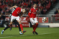 February 17, 2018 - Lisbon, Portugal - Benfica's defender Ruben Dias (L) heads the ball to score his side's first goal  during Primeira Liga 2017/18 match between SL Benfica vs Boavista FC, in Lisbon, on February 17, 2018. (Credit Image: © Carlos Palma/NurPhoto via ZUMA Press)