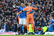 Connor Goldson (#6) of Rangers FC celebrates victory with Allan McGregor (#1) of Rangers FC and Joe Worrall (#3) of Rangers FC during the Ladbrokes Scottish Premiership match between Rangers and Celtic at Ibrox, Glasgow, Scotland on 29 December 2018.