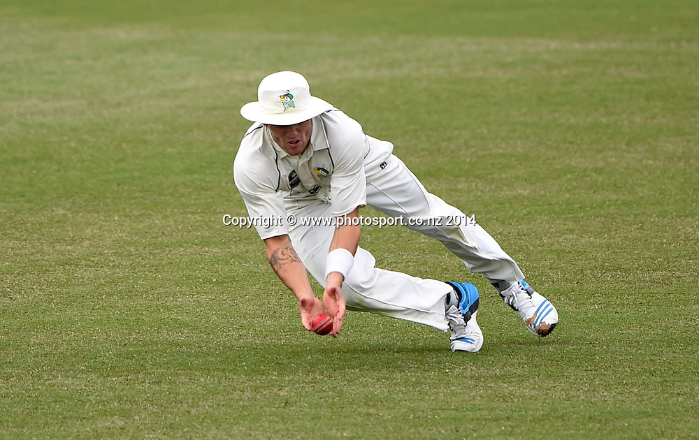 CD's Doug Bracewell takes a catch to dismiss Colin Munro during the Plunket Shield 4 day cricket match between Auckland Aces and Central Stags at the Eden Park Outer Oval, Auckland, New Zealand. Thursday 18 December 2014. Photo: Andrew Cornaga/www.Photosport.co.nz