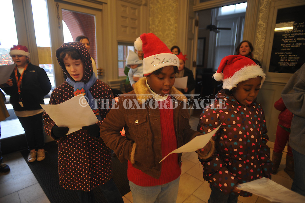 Daisies, Brownies and Girl Scouts sing Christmas carols at City Hall in Oxford, Miss. on Thursday, December 16, 2010.