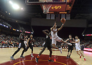 Dec 19, 2017; Los Angeles, CA, USA; Southern California Trojans guard Jordan McLaughlin (11) shoots the ball as Princeton Tigers guard Amir Bell (5) defends during an NCAA basketball game at Galen Center. Princeton defeated USC 103-93 in overtime.