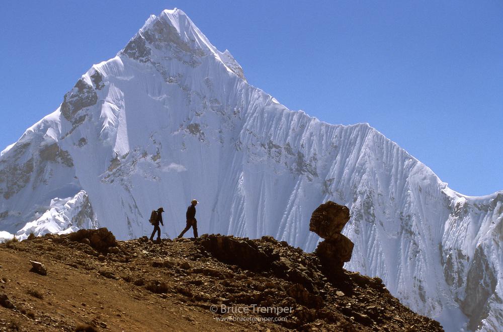 Bob Greely and Susi Hauser on a high pass with Yerupaja looming behind them.  Huayhuash Range, Peru