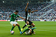 Dale Stephens (#6) of Brighton & Hove Albion slides in to the win the ball from Isaac Hayden (#14) of Newcastle United during the Premier League match between Newcastle United and Brighton and Hove Albion at St. James's Park, Newcastle, England on 21 September 2019.