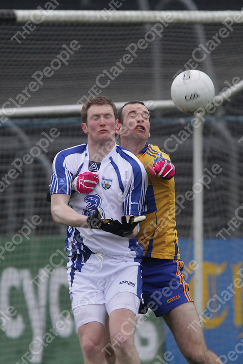Clare's Lawrence Healy punches the ball away from Waterford's Liam O'Lonain as he is about to collect during their Division 4 clash @ Cusack Park. - Photograph by Flann Howard