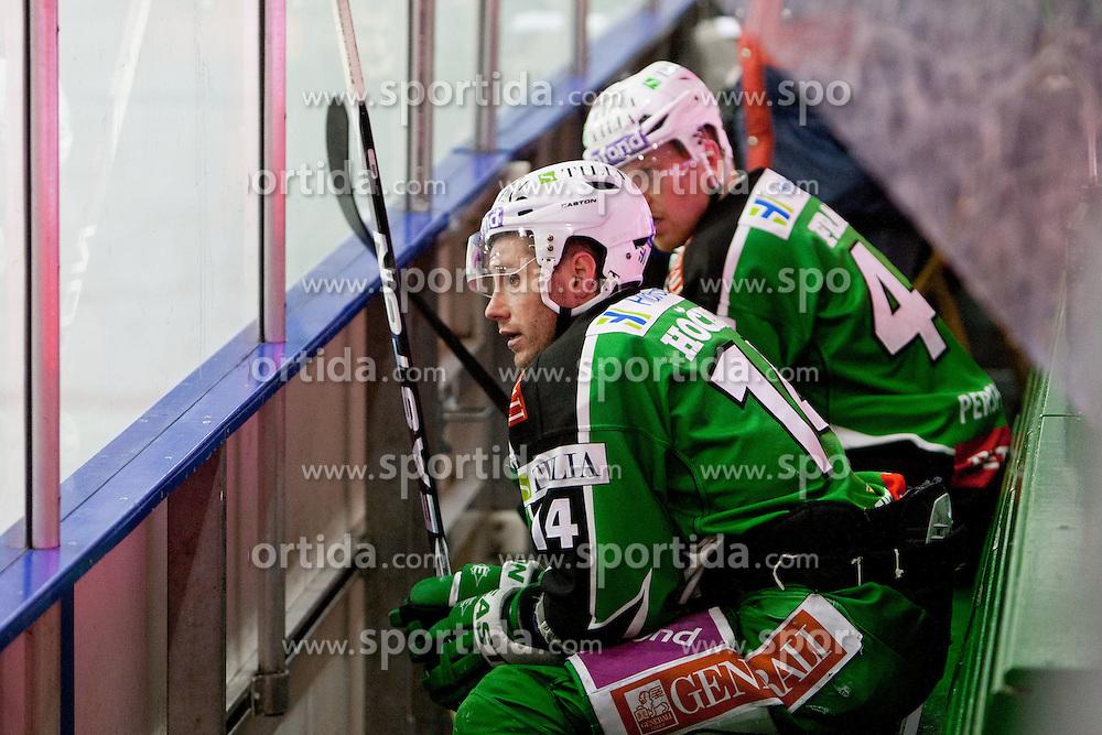 Matej Hocevar (HDD Tilia Olimpija, #14) and Jamie Fraser (HDD Tilia Olimpija, #44) during ice-hockey match between HDD Tilia Olimpija and EC Red Bull Salzburg in 48th Round of EBEL league, on January 29, 2012 at Hala Tivoli, Ljubljana, Slovenia. (Photo By Matic Klansek Velej / Sportida)