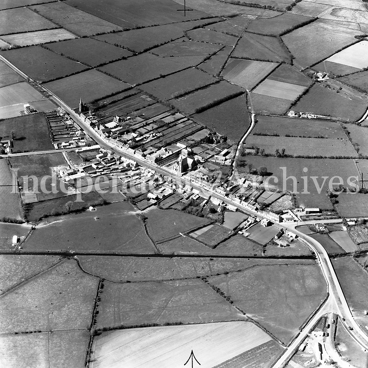 A248 Kinnegad.   04/12/53. (Part of the Independent Newspapers Ireland/NLI collection.)<br /> <br /> <br /> These aerial views of Ireland from the Morgan Collection were taken during the mid-1950's, comprising medium and low altitude black-and-white birds-eye views of places and events, many of which were commissioned by clients. From 1951 to 1958 a different aerial picture was published each Friday in the Irish Independent in a series called, 'Views from the Air'.The photographer was Alexander 'Monkey' Campbell Morgan (1919-1958). Born in London and part of the Royal Artillery Air Corps, on leaving the army he started Aerophotos in Ireland. He was killed when, on business, his plane crashed flying from Shannon.