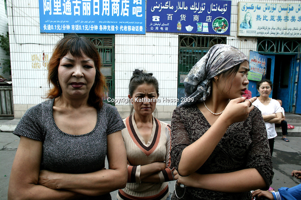 URUMQI, JULY-15 : Patiguli Palachi, left, with her stepdaughter, says she has gone to the police station every day since her husband was arrested.