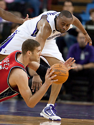 November 27, 2009; Sacramento, CA, USA;  New Jersey Nets center Brook Lopez (11) dives to save a loose ball in front of Sacramento Kings forward Kenny Thomas (9) during the fourth quarter at the ARCO Arena. Sacramento defeated New Jersey 109-96.