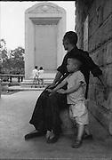 C003-12 Tom Hutchins_Man and boy, monument Canton (Guangzhou) 1956.tif