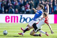 ROTTERDAM  - Feyenoord - PSV , eredivisie , voetbal , Feyenoord stadion de Kuip , seizoen 2014/2015 , 22-03-2015 , Feyenoord speler Jens Toornstra (r) en PSV speler Andres Guardado (l) gaan beide voor de bal