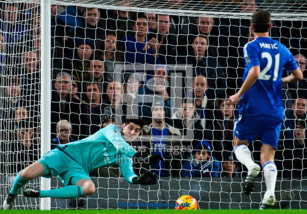 Thibaut Courtois of Chelsea makes a save during the Barclays Premier League match at Stamford Bridge, London<br /> Picture by Jack Megaw/Focus Images Ltd +44 7481 764811<br /> 05/12/2015