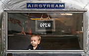 Henry Arthur-Durett, 9 months, looks out the window of the Strom Coffee Airstream trailer Wednesday in John Dam Plaza in Richland while his dad James Durett, of Richland, enjoys a cup of coffee.