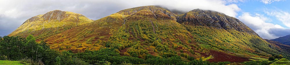 Ben Nevis range from Glen Nevis showing autumnal colours. Ben Nevis (to  left) is the highest mountain in the British Isles. It is in the Lochaber area of the Scottish Highlands, close to the town of Fort William.