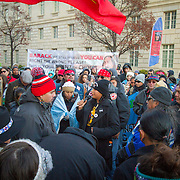 Jasilyn Charger, 20, Cheyenne River Sioux, speaks to demonstrators in front of the EPA, on Saturday, December 10, 2016.  By chance, Charger happened to be in the area and heard the drumming and the protests and walked over to over words of encouragement to the rally.  The protest was in support of the demonstrations at Standing Rock, North Dakota, regarding the North Dakota Access Pipeline, as well as the effort to free Leonard Peltier. John Boal Photography