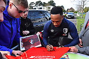 Nathaniel Clyne (23) of AFC Bournemouth signs a fans Liverpool shirt as he arrives at the Vitality Stadium before the Premier League match between Bournemouth and Manchester City at the Vitality Stadium, Bournemouth, England on 2 March 2019.
