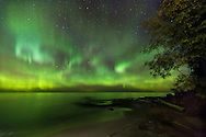 The Aurora Borealis dances across the night sky along the Lake Superior shore - Michigan's Western Upper Peninsula