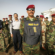 30th April 2006..Basra, Iraq..Iraq/Iran Border Enforcement..British soldiers from the 9/12 Lancers work alongside Iraqi Security Forces along the Iraq/Iran border. The task is to combat smuggling of people, weapons and fuel across the river...Brigadier Hussien Jabory Abood (45) (center) leads a squad of Iraqi commandos based in a border fort on the Shat al-Arab waterway. His team seach all boats passing the fort and have killed several smugglers who refused to stop and have captured weapons and illegal imigrants.