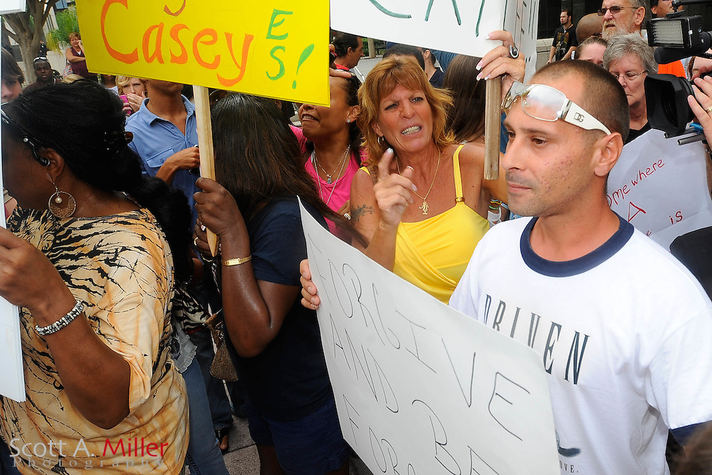 A pro-Casey Anthony supporter is shouted down by anti-Anthony protesters during sentencing outside the Orange County July 7, 2011 in Orlando, FL...©2011 Scott A. Miller