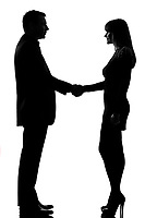one caucasian couple man and woman handshake in studio silhouette isolated on white background