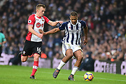 Southampton midfielder James Ward-Prowse (16) comes in to tackle West Bromwich Albion striker Saloman Rondon (9) during the Premier League match between West Bromwich Albion and Southampton at The Hawthorns, West Bromwich, England on 3 February 2018. Picture by Dennis Goodwin.