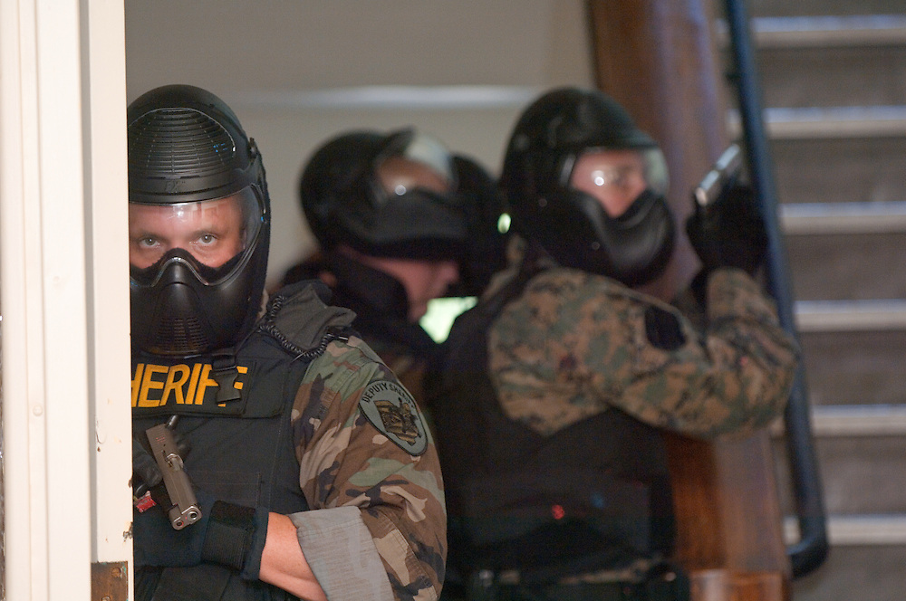 18398..Members of Logan/Hocking Co. Joint S.R.T., Delaware County PD,Canton PD, Wilmington PD, US Marine Core, and Ohio University PD practice SWAT drills at Tupper Hall on Friday, September 21st.