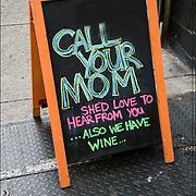 Blackboard humorous  outdoor wine stor sign.