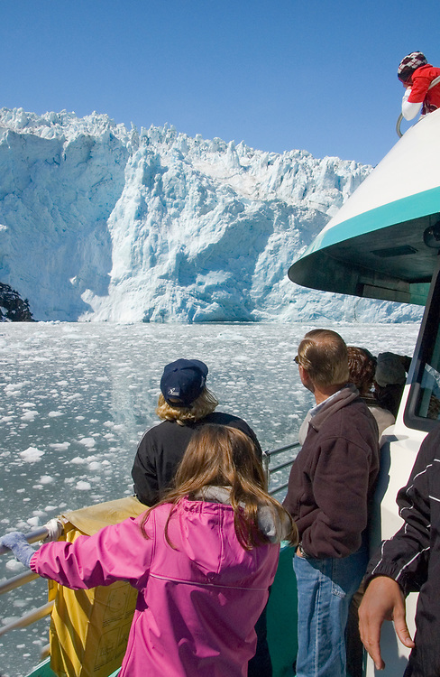 A tour boat gets close to a calving glacier in Resurrection Bay near Seward, Alaska.