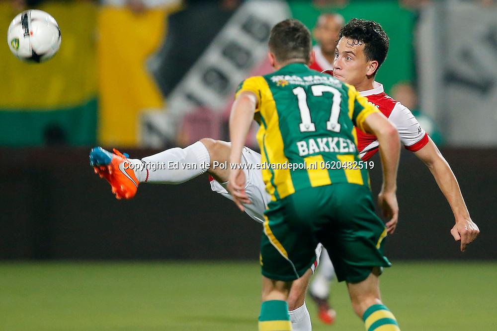 DEN HAAG - 27-09-2014 - ADO - AZ, Kyocera Stadion, 2-3, \AZ speler Thom Haye (r), ADO Den Haag speler Danny Bakker (l).
