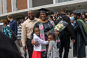 Jada Peterson poses for a photo with her family after receiving her MBA. Photo by Ben Siegel