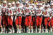COLLEGE FOOTBALL:  Stanford Cardinal football team members including Tyler Batson #61, future Stanford head coach David Shaw #84, Tommy Knecht #14, Mike Cook #14, Ron Redell #10, and Kwame Ellis #8  jog on the field prior to the 1992 Big Game vs Cal played on November 21, 1992 at Memorial Stadium in Berkeley, California. Photograph by David Madison (www.davidmadison.com)