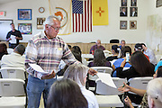 Navajo community leader Daniel Tso hands out information at a meeting at the chapter house in Counselor New Mexico where the Bureau of Land Management was hearing public comments on proposed new sites for leasing rights to additional drilling in the San Juan Basin.
