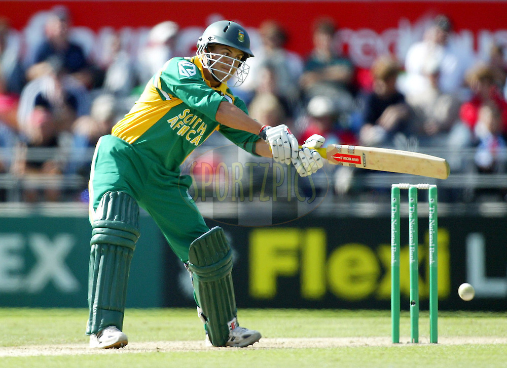 17 February 2004. New Zealand vs South Africa International one day cricket at Jade Stadium, Christchurch, New Zealand. Match 2 in series of 6..South African batsman Jacques Rudolph cuts during his innings of 42. At the tea break and after 50 overs South Africa were 253 for 8 wickets..Please credit: Andrew Cornaga/Photosport
