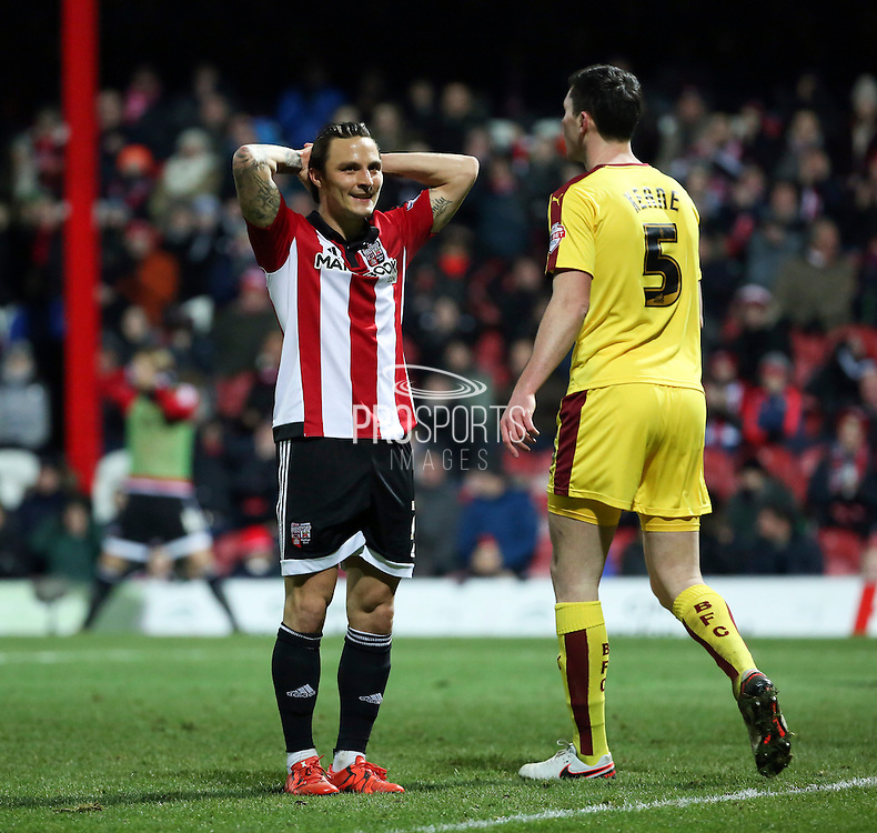 Brentford midfielder Sam Saunders after sustained Brentford pressure during the Sky Bet Championship match between Brentford and Burnley at Griffin Park, London, England on 15 January 2016. Photo by Matthew Redman.