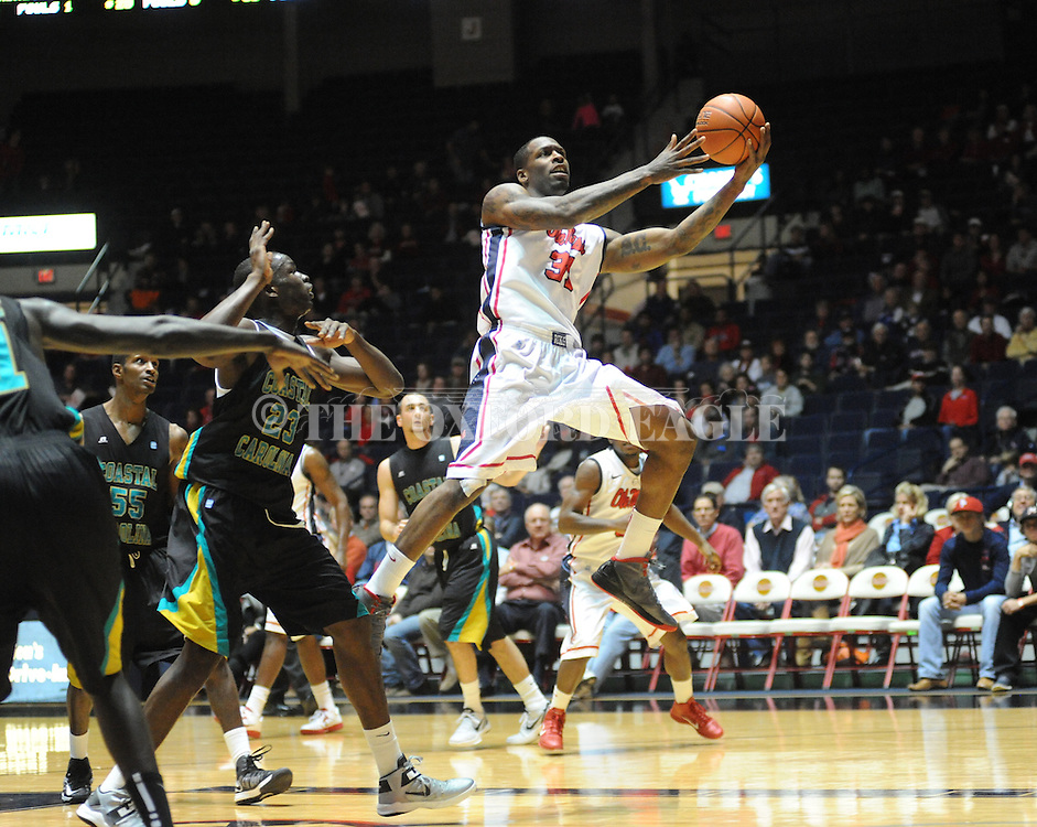 """Ole Miss' Murphy Holloway (31) is fouled by Coastal Carolina's Badou Diagne (23) at the C.M. """"Tad"""" Smith Coliseum in Oxford, Miss. on Tuesday, November 13, 2012. (AP Photo/Oxford Eagle, Bruce Newman)"""