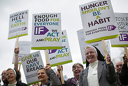 "© licensed to London News Pictures. London, UK 15/05/2013. Around 300 nuns, priests, monks and ""Enough food for everyone IF campaign"" supporters marching to Houses of Parliament in London to protest global hunger and lobby their MPs. Photo credit: Tolga Akmen/LNP"
