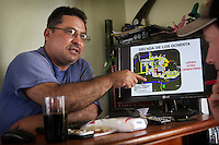 Luiz alberto Gomez points at his screen with a map of all the locations where some one died in the eighties, about 170 of them in a community <br /> A view of Lerma, a small coca producing community in the south of Cauca department. The region is controlled by the ELN guerrilla group. There's no official authority in town.