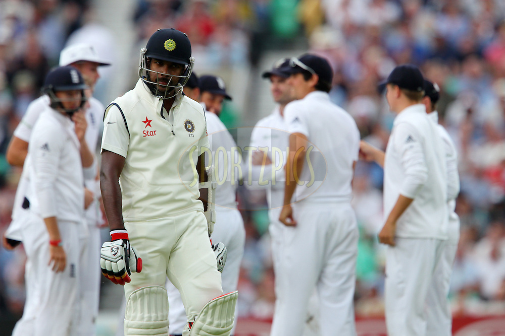 Varun Aaron of India departs during day one of the fifth Investec Test Match between England and India held at The Kia Oval cricket ground in London, England on the 15th August 2014<br /> <br /> Photo by Ron Gaunt / SPORTZPICS/ BCCI