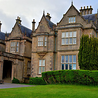 Muckross House in Killarney, Ireland<br /> Henry Arthur Herbert was a member of Parliament and the Chief Secretary of Ireland during the mid-19th century. He commissioned William Burn to design this incredible residence. The Muckross House was finished in 1843. Its namesake is the Muckross Peninsula where this 65 room, Tudor mansion stands with a panoramic view of the lake.  In 1899, it was purchased by Arthur Guinness, the great-grandson of the famous Irish stout brewmaster.  In 1911, the house was acquired by William Bourn and then given to his daughter and son-in-law, Arthur Rose Vincent, as a wedding present. Twenty-one years later, the family gifted it to Ireland. Together with the surrounding 11 acres, the property became the Bourn Vincent National Park. Since then it has become part of the larger Killarney National Park.