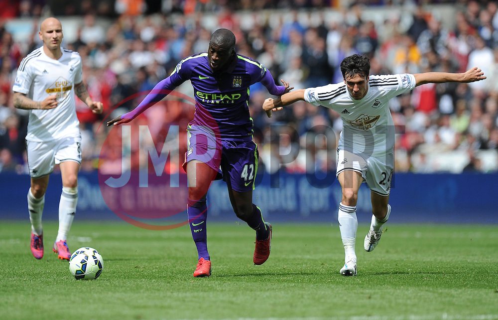 Manchester City's Yaya Toure battles for the ball with  Swansea City's Jack Cork - Photo mandatory by-line: Alex James/JMP - Mobile: 07966 386802 - 17/05/2015 - SPORT - Football - Swansea - The Liberty stadium - Swansea City v Manchester City - Barclays premier league