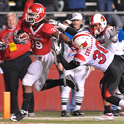 Dec. 4, 2008; Piscataway, NJ, USA; Louisville defensive back Daniel Covington (30) pulls down Rutgers running back Jourdan Brooks during the second quarter of Rutgers' 63-14 victory at Rutgers Stadium.