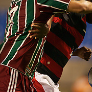 Fluminense and Flamengo players challenge for the ball during the Flamengo V  Fluminense, Futebol Brasileirao  League match at Estadio Olímpico Joao Havelange, Rio de Janeiro, The classic Rio derby match ended in a 3-3 draw. Rio de Janeiro,  Brazil. 19th September 2010. Photo Tim Clayton.