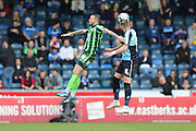 Rhys Murphy forward for AFC Wimbledon (39) and Wycombe Wanderers striker Paul Hayes (captain) (9) jump for the ball during the Sky Bet League 2 match between Wycombe Wanderers and AFC Wimbledon at Adams Park, High Wycombe, England on 2 April 2016. Photo by Stuart Butcher.